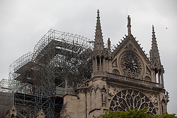 Firefighters inspect Notre Dame Cathedral after a giant fire was put down. French President Emmanuel Macron vowed to rebuild the 13th century building that welcomes tens of millions of worshippers and tourists per year. Paris, France, April 16, 2019. Photo by Ania Freindorf/ABACAPRESS.COM