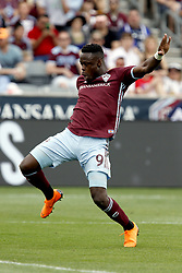 April 29, 2018 - Commerce City, Colorado - Colorado Rapids forward Yannick Boli (9) attempts to get a shot off before the Orlando goalkeeper can get to the ball in the second half of action in the MLS soccer game between Orlando City SC and the Colorado Rapids at Dick's Sporting Goods Park in Commerce City, Colorado (Credit Image: © Carl Auer via ZUMA Wire)