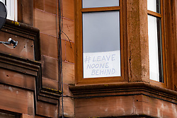 Glasgow, Scotland, UK. 3 April, 2020. Images from the south side of Glasgow at the end of the second week of Coronavirus lockdown. Pictured; hand drawn message in window of flat in Govanhill . Iain Masterton/Alamy Live News