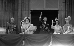 King George VI and Queen Elizabeth acknowledge the crowds on the balcony of Buckingham Palace. Alongside them are (L-R) The Duke and Duchess of Gloucester, Princess Margaret and Queen Mary.