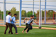Members of the Free Syrian Army (FSA) - who are also local residents in Marea, are seen playing footbal in the outskirt of the city on Monday, June 25, 2012. (Photo by Vudi Xhymshiti)