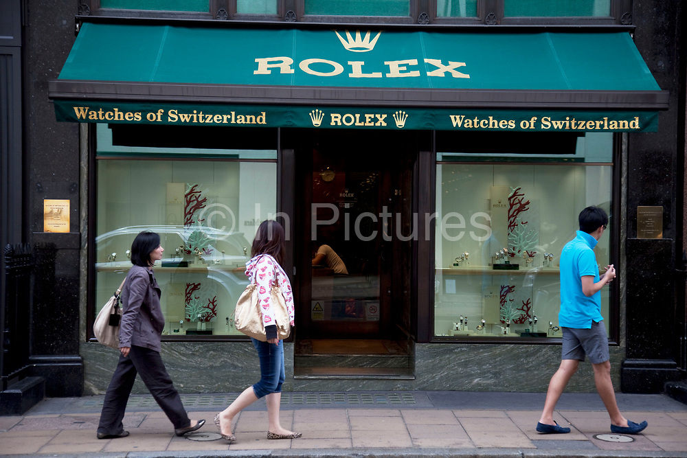 """Rolex. Exclusive shops on New Bond Street, Mayfair, central London. It is one of the principal streets in the West End shopping district and is more upmarket. It has been a fashionable shopping street since the 18th century. Technically """"Bond Street"""" does not exist: The southern section is known as Old Bond Street, and the northern section, which is rather more than half the total length, is known as New Bond Street. The rich and wealthy shop here mostly for high end fashion and jewellery."""