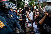 California Highway Patrol officers use their batons to hold back protesters on the east side of the Capitol in downtown Sacramento on Saturday, May 30, 2020. Around 1000 protesters converged to the Capitol on early Saturday to protest the death of Minnesota man George Floyd.