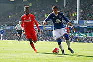 Ramiro Funes Mori of Everton is chased by Daniel Sturridge of Liverpool. Barclays Premier League match, Everton v Liverpool at Goodison Park in Liverpool on Sunday 4th October 2015.<br /> pic by Chris Stading, Andrew Orchard sports photography.