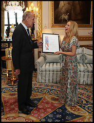 April 4, 2017 - London, London, United Kingdom - Image ©Licensed to i-Images Picture Agency. 04/04/2017. London, United Kingdom. Kylie Minogue at Windsor Castle..The Duke of Edinburgh, Patron of the Britain-Australia Society, presents Kylie Minogue with the Britain-Australia Society Award for 2016 during a private audience in the White Drawing Room at Windsor Castle, in Berkshire. The Britain-Australia Award recognises Australian and British individuals who have made a significant contribution to the Australia-UK bilateral relationship. Past recipients include Barry Humphries, and The Rt Hon Lord Hague PC. Picture by  i-Images / Pool (Credit Image: © i-Images via ZUMA Press)