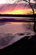 Partially frozen Lake Harriet at sunset.  Minneapolis Minnesota USA