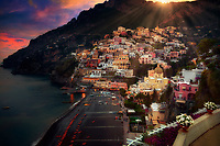 """""""Mystical Rays of the Evening Sun Shine Above Positano""""…<br /> <br /> After an exhilarating drive along the high cliffs on the Amalfi Coast from Sorrento down to Positano, I found myself in sensory overload with its beauty and photogenic appeal. Circling the entire village and its cliffside three times on Positano's only street, which was a single lane winding down from the top and back up and over to where I began, I finally found the parking garage by the hotel, about 2/3rds up the facing village in this image.  The climb down the winding road and steep staircases made for quite a workout in the hot late May sun.  Reaching the beach and marina, I forgot about my exhaustion and could not capture enough of Positano's plush beauty; however, the large number of tourists and the bright sun did not allow for ideal conditions.  Walking the length of the beach, I found a very, very steep staircase leading straight up to a large veranda at the Albergo California.  Taking an exhaustive seat on a plush lounge chair with a perfect view to watch the sunset behind the Amalfi Cliffs, I was taken back by a pleasant Italian (Positano) waiter from the hotel offering a towel, ice water, and drinks for the evening.  I expressed that I was not staying at the hotel, but he didn't seem to mind and proceeded to educate me on the culture of this historic resort village.  The sunset was being coy and didn't appear to cooperate, but during opportune moments it mystified the cloud arrangement and contributed just enough rays of light and color to satisfy a weary photographer."""