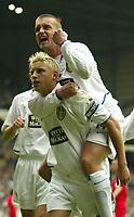 Photo Aidan Ellis.<br /> Digitalsport<br /> NORWAY ONLY<br /> <br /> Leeds United v Charlton Athletic.<br /> FA Barclaycard Premiership.<br /> 08/05/2004.<br /> Leeds Stephen Mcphail jumps on third goal scorer Alan Smith's back