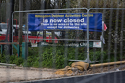 Harefield, UK. 6th April, 2021. A sign indicating that the Hillingdon Outdoor Activities Centre has been closed down due to works for the HS2 high-speed rail link. Thousands of trees have already been felled in the Colne Valley where HS2 works will include the construction of a Colne Valley Viaduct across lakes and waterways and electricity pylon relocation.
