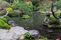 Jizo-ji Temple Garden belongs to the Soto Zen sect of Buddhism. There is garden of kaiyu shiki teien style of the early Edo period.  Here, the backdrop and borrowed scenery have been used skillfully. Its unique Y shaped waterfall, is an unusual addition.  There is an stone bridge the crosses over the pond, festooned with iris in season while tiny islands appear to be afloat within the pond.  The garden at Jizo-ji Temple is almost hidden and takes some effort to find it behind the main hall.  Seeking it out is well worth the effort.