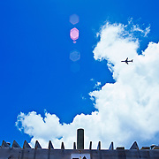 Airplane pasing over sign.<br /> Puerto Rico Island, USA.