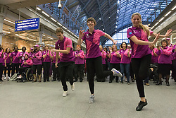 © licensed to London News Pictures. London, UK 26/10/2012. Team London Ambassadors staging a 'musical surprise' for visitors and commuters travelling on the Eurostar. The Ambassadors are set to be involved in a series of pilots across London, supporting international sporting events and tourists during busy holiday periods. Photo credit: Tolga Akmen/LNP