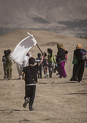 October 21, 2016 - Nineveh Governorate, Iraq - Civilians escape from Khorsabad which is controlled by the isis and under Peshmerga fire. (Credit Image: © Bertalan Feher via ZUMA Wire)