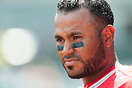 Gregorio Petit looks out from the dugout during the Angels' preseason game against the Chicago Cubs at Angel Stadium Sunday.<br /> <br /> <br /> ///ADDITIONAL INFO:   <br /> <br /> angels.0404.kjs  ---  Photo by KEVIN SULLIVAN / Orange County Register  --  4/3/16<br /> <br /> The Los Angeles Angels take on the Chicago Cubs at Angel Stadium during a preseason game at Angel Stadium Sunday.<br /> <br /> <br />  4/3/16