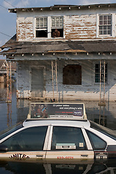 05 Sept 05. New Orleans Louisiana.  Hurricane Katrina aftermath.<br /> Residents who refuse to leave. Leaning from a top floor window above the water level, Rogers Jefferson, a resident of Uptown New Orleans refuses to leave the devastated flood areas.<br /> Photo; ©Charlie Varley/varleypix.com