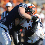 Princeton quarterback Connor Michelsen is sacked by, Jack Rushin, Yale, during the Yale Vs Princeton, Ivy League College Football match at Yale Bowl, New Haven, Connecticut, USA. 15th November 2014. Photo Tim Clayton