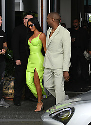 Kim Kardashian wears a neon yellow latex dress as she and husband Kanye West arrive to the wedding of 2 Chainz at the Versace Mansion in Miami Beach, Florida. 18 Aug 2018 Pictured: Kim Kardashian West; Kanye West; Kim Kardashian. Photo credit: MEGA TheMegaAgency.com +1 888 505 6342