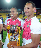 England's Marcus Watson, left and Dan Norton with the cup after they defeated Kenya in the final at the IRB International Rugby Sevens, Westpac, Wellington, New Zealand, Saturday, February 02, 2013. Credit:SNPA / Ross Setford