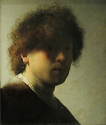 Self-Portrait of Rembrandt Harmensz van Rijn (1606-1669), oil on panel, c1628. Even as an inexperienced young artist, Rembrandt did not shy away from experimenting.  Here the light glances along his right cheek, while the rest of his face is veiled in shadow.  It takes a while to realise that the artist is gazing intently out at us.  Using the butt end of his brush,  Rembrandt made scratches in the still wet paint to accentuate the curls of his tousled hair.
