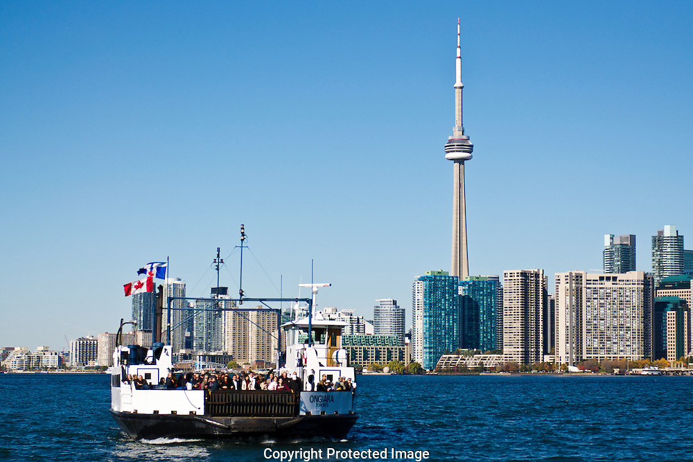 The Toronto Islands offer a great visual perspective of the city skyline.  The ferry in the foreground is the lifeline for most island residents.