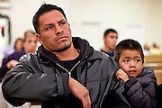 19 DECEMBER 2010 - PHOENIX, AZ: LUIS VALENTAN, and his son, OCTAVIO VALENTAN, 4, at a prayer service for the DREAM Act in Phoenix. About 100 supporters of the DREAM Act gathered at First Congregational Church of Christ in Phoenix Sunday night, December 19, for a prayer vigil in support of the DREAM Act, which was defeated in the US Senate Saturday, Dec. 18. The DREAM Act, was supported by the Obama administration, and was an important part of the administration's immigration reform platform. The defeat of the DREAM Act, which would have established a path to citizenship for undocumented immigrants who were brought to the US by their parents when they were children, set back the President's immigration reform efforts.    PHOTO BY JACK KURTZ