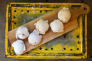 "Ice Cream flavored with beer at Salt & Straw, an ice cream scoop shop in Portland, Oregon.   The ""Six Pack"" of beer flavored ice cream. <br /> From bottom left: Passionfruit Berliner Weisse in Coconut Water Sorbet, Bretta Fermented Pears and Fudge, Bourbon Barrel Aged Stout, Smoked Hafaweizen, Hopped Farmhouse Ale, IPA Upside Down Cake"