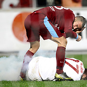 Trabzonspor's Remzi Giray Kacar and Galatasaray's Burak Yilmaz (R) during their Turkish superleague soccer derby match Trabzonspor between Galatasaray at the Avni Aker Stadium in Trabzon Turkey on Sunday, 23 December 2012. Photo by TURKPIX