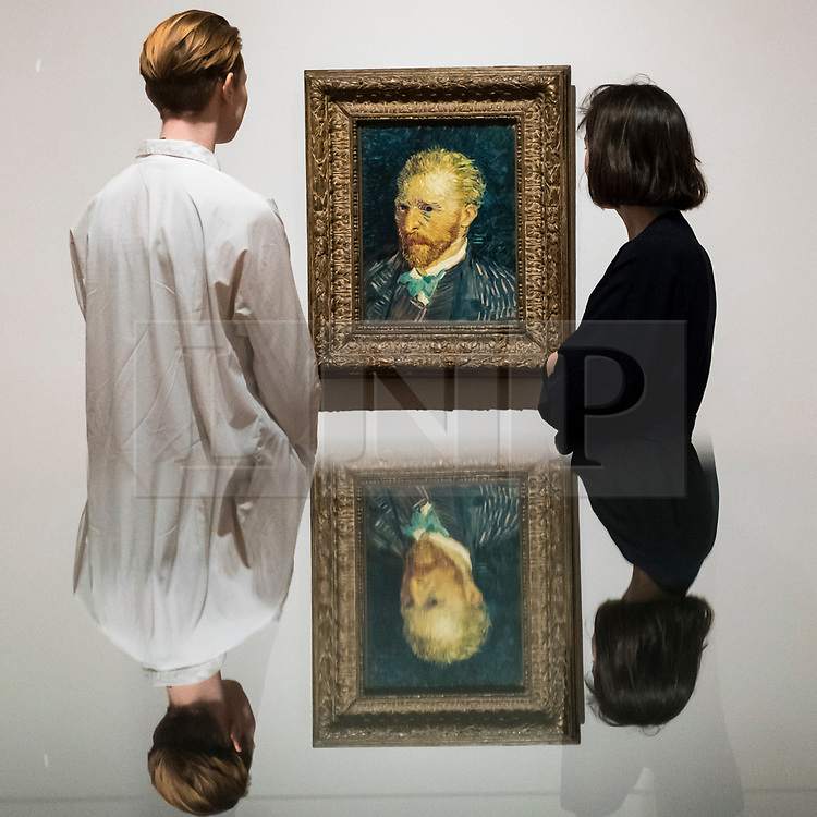 """© Licensed to London News Pictures. 25/03/2019. LONDON, UK. Staff members view """"Self-Portrait"""", 1887, by Vincent Van Gogh.  Preview of """"The EY: Van Gogh and Britain"""" exhibition at Tate Britain, the first exhibition to look at the work of Vincent Van Gogh through his relationship with Britain and how he inspired British artists.  Over 50 of his works are on display 27 March to 11 August 2019.  Photo credit: Stephen Chung/LNP"""