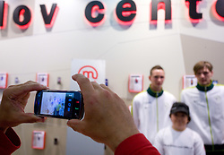 Fan takes a picture with a mobile phone of Tim Matavz and Milivoje Novakovic at visit  of Slovenian National Football team in Mobitel center, on May 19, 2010 in Ciytpark, BTC, Ljubljana, Slovenia. (Photo by Vid Ponikvar / Sportida)