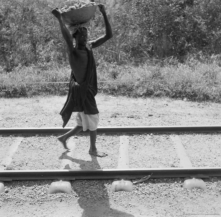 Man with Basket Walking on Train Tracks, Lagos, Nigeria, Africa, 1937