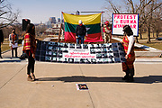 06 MARCH 2021 - DES MOINES, IOWA: Members of Iowa's Burmese community hold up a banner with photos of people killed by Myanmar authorities after the coup in Myanmar. About 300 members of the Burmese community in Iowa gathered at the State Capitol in Des Moines Saturday to protest against the military coup that deposed the popularly elected government of Aung San Suu Kyi and continuing military oppression in Myanmar. There are about 10,000 people in Iowa's Burmese community.          PHOTO BY JACK KURTZ