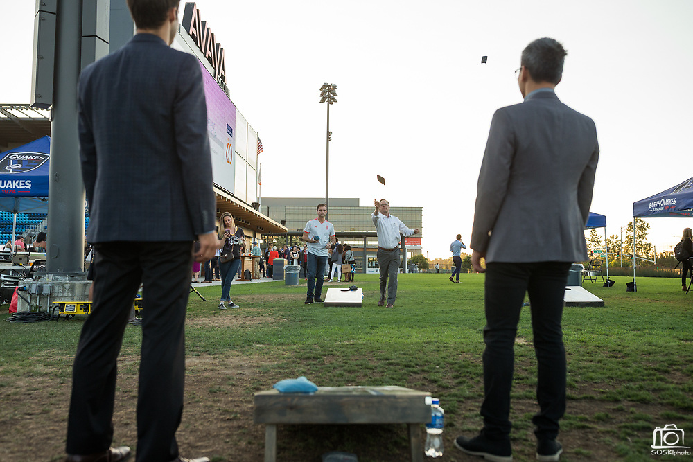 Guests play corn hole during the Silicon Valley Business Journal 40 Under 40 event at Avaya Stadium in San Jose, California, on July 31, 2018. (Stan Olszewski for Silicon Valley Business Journal)