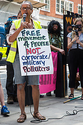 London, UK. 29 July, 2019. Sara Callaway of Women of Colour in the Global Women's Strike addresses activists from Reclaim the Power, All African Women's Group, Docs Not Cops, Lesbians and Gays Support the Migrants and other groups at a protest outside the Home Office to demand an end to the Government's 'hostile environment' policies.