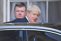 © Licensed to London News Pictures. 24/07/2019. London, UK.  New Conservative Party leader BORIS JOHNSON is seen leaving a temporary office in Whitehall in Westminster, London. The Conservative Party has elected Boris Johnson as their new leader and Prime Minister, following Theresa May's announcement that she will step down. Photo credit: Ben Cawthra/LNP
