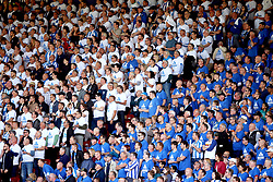Huddersfield Town fans in the stands wear their teams kit in order to show their support during the match
