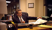 Lawyer age 27 working at desk.  Chicago  Illinois USA