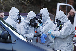 © Licensed to London News Pictures. 07/03/2018. Salisbury, UK. Police seen putting on protective suits and gas masks in preparation to carry out further investigation work, in Salisbury. Former Russian spy Sergei Skripal and his daughter were taken il following a suspected poisoning in the city. The couple where found unconscious on bench in Salisbury shopping centre. Specialist units have been called in to deal with any possible contamination. Photo credit: Peter Macdiarmid/LNP