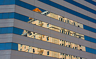 The new building's windows provide an intriguing reflection -- distortion of the classic building next door.  The contrast is stunning between the stark minimalism of the new building and the warm intricacy of the old.  It is a story of increasing emphasis on efficiency and cost controls in architecture that hints at the demise of humanness.  The contrasting colors emphasize the inexorable march toward modernism while providing photographic beauty.<br /> Won a 1st place in the 2018 California State Fair and a 2nd place in the 2018 Nevada County District Fair.