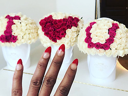 """Melanie Brown releases a photo on Instagram with the following caption: """"I love you more \u2665\ufe0f\ud83d\udc9c\u2665\ufe0f #valentines #roses #early"""". Photo Credit: Instagram *** No USA Distribution *** For Editorial Use Only *** Not to be Published in Books or Photo Books ***  Please note: Fees charged by the agency are for the agency's services only, and do not, nor are they intended to, convey to the user any ownership of Copyright or License in the material. The agency does not claim any ownership including but not limited to Copyright or License in the attached material. By publishing this material you expressly agree to indemnify and to hold the agency and its directors, shareholders and employees harmless from any loss, claims, damages, demands, expenses (including legal fees), or any causes of action or allegation against the agency arising out of or connected in any way with publication of the material."""