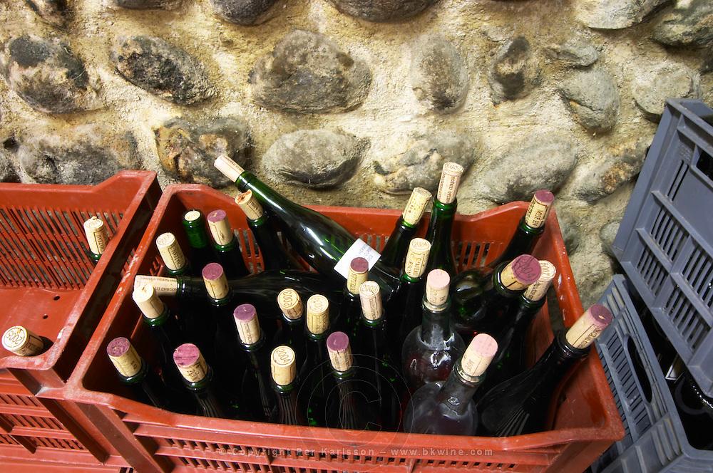 wine bottles in a plastic crate chateau curson dom pochon crozes hermitage rhone france