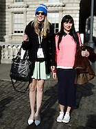 Two unidentified guests pose for photographs at Somerset House during London Fashion Week Fall/Winter 2013 in London, Britain, 18 February 2013. The fashion week runs from 15 to 19 February. Flying from New York before travelling to Milan, the fashion industry makes a stop in London to present its Fall/Winter 2013 collections. Over five days models, designers, buyers, bloggers, photographers, makeup artists, hair dressers, celebrities and hipsters congregate at Somerset House for a celebration of cutting edge style. Style is not only reserved to the catwalk. Guests also compete in creativity, often going to extreme lengths to be the coolest cat in town. And London certainly has its fair share of cool cats.
