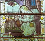 Stained glass window detail of child with doves Hacheston church, Suffolk, England, UK c 1922 by Kempe and Co