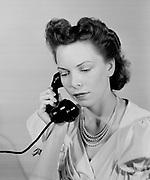 0003-003. Telephone conversation. Marian Fresk (wife of photographer) Ca, 1942.
