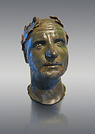 Bronze head of possibly Trebonianus Gallus, 251-253 A.D., inv 15032, Vatican Museum Rome, Italy, grey background ..<br /> <br /> If you prefer to buy from our ALAMY STOCK LIBRARY page at https://www.alamy.com/portfolio/paul-williams-funkystock/greco-roman-sculptures.html . Type -    Vatican    - into LOWER SEARCH WITHIN GALLERY box - Refine search by adding a subject, place, background colour, museum etc.<br /> <br /> Visit our CLASSICAL WORLD HISTORIC SITES PHOTO COLLECTIONS for more photos to download or buy as wall art prints https://funkystock.photoshelter.com/gallery-collection/The-Romans-Art-Artefacts-Antiquities-Historic-Sites-Pictures-Images/C0000r2uLJJo9_s0c