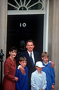 The newly-elected British Labour Prime Minister Tony Blair stands on the steps of Number 10 Downing Street with his wife Cherie and three children Euan; Kathryn and Nicky, the morning after his landslide election victory over the Conservative John Major, on 2nd May 1997, in Westminster, England. (Photo by Richard Baker / In Pictures via Getty Images)