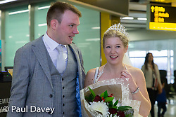 SWSYmarried: Sarah Elliott, 34, and Paul Edwards, 36, who met on the dating app Bumble on 15th December - meet in person for the first time as they fly off to Las Vegas from Gatwick to get married. Gatwick, Sussex, December 24 2018.
