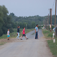 Illegal migrants are crossing a road on the outskirt of Szeged (about 173 km South-East of capital city Budapest), Hungary on July 16, 2015. ATTILA VOLGYI