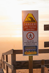 Danger information sign on the beach and stairs moving down to the beach, Lit-et-Mixe, Aquitaine, France
