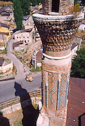 The Gök Medrese (Celestial or Sky-Blue Seminary) was built in 1277 AD after the fall of the Seljuks and the arrival of the Mongols, near Sivas, in the present-day Republic of Turkey. It was a hospital until 1811 and is now a museum. This view is from stop one minaret looking towards the other.