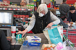 ©Licensed to London News Pictures 18/03/2020<br /> Petts Wood, UK. An elderly shopper with a protective mask on this morning at the Iceland store in Petts Wood, Greater London. Iceland stores in the UK have allocated the first two hours of a trading day to the over sixty fives and the vulnerable because of the impact of Coronavirus on food supplies. Photo credit: Grant Falvey/LNP
